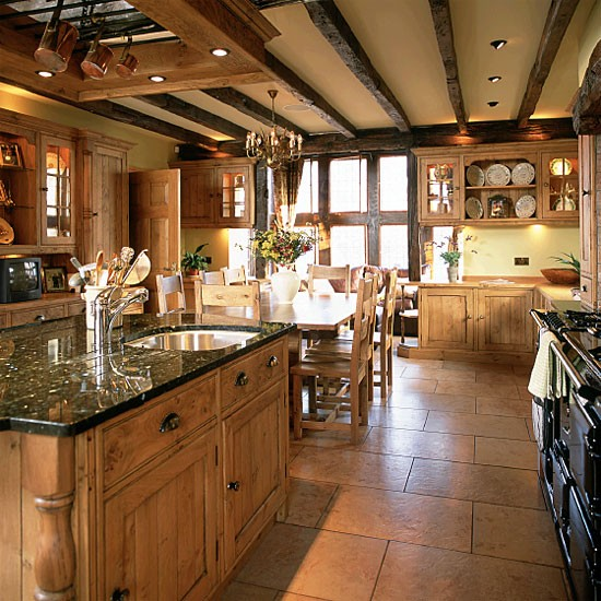 Country kitchen with wooden units and beams housetohome for Country kitchen floor ideas