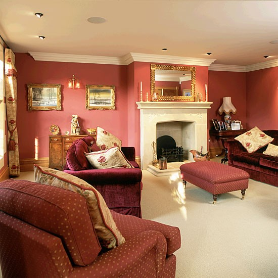 living room with red walls and sofas
