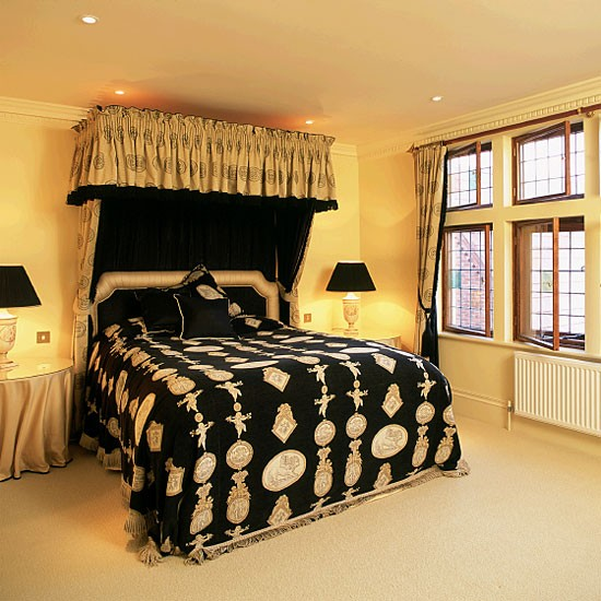 Yellow bedroom with black patterned canopied bed for Black and yellow bedroom designs