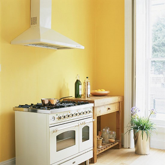 Yellow Kitchen With Range Cooker And Butcher's Table
