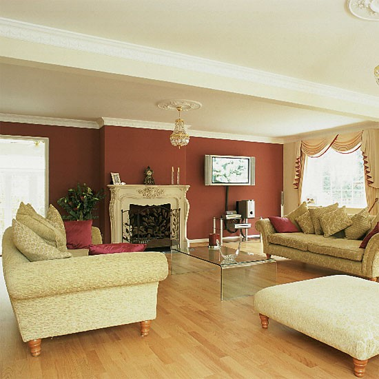 Living room with red and cream walls plus an ornate fireplace - Living room with cream walls ...