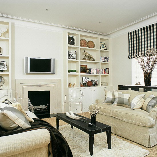 living room with shelving and black accessories