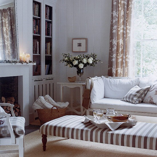 Neutral Living Room With Sofa Floral Curtains And Striped Stool