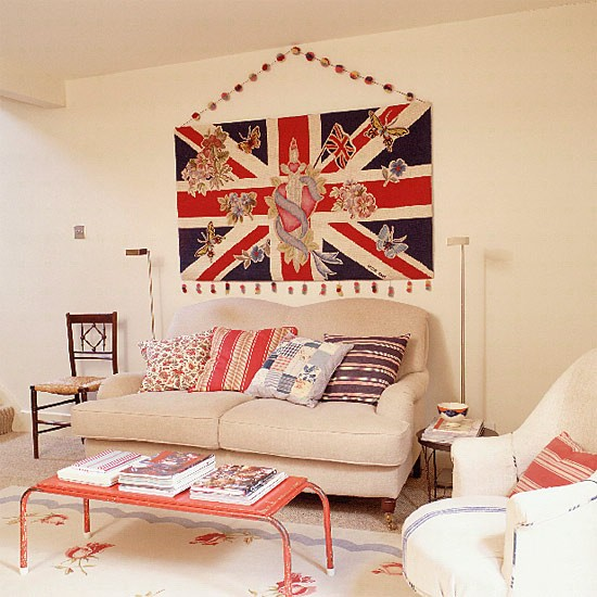 living room with union jack wallhanging sofa and coffee