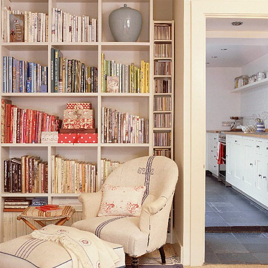 Living Room With Bookshelves And Armchair