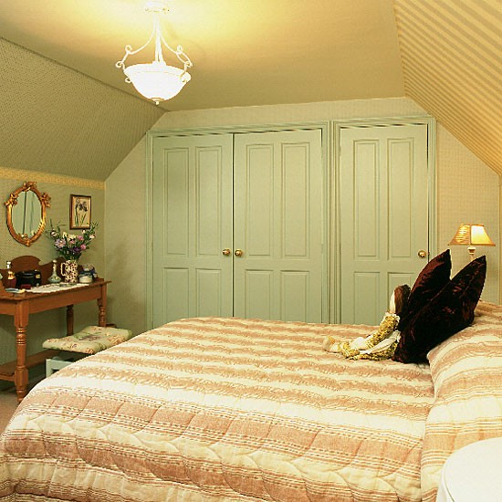 Bedroom With Built-in Wardrobe, Striped Walls And Quilt