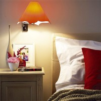 Bedroom with orange lamp and red pillow