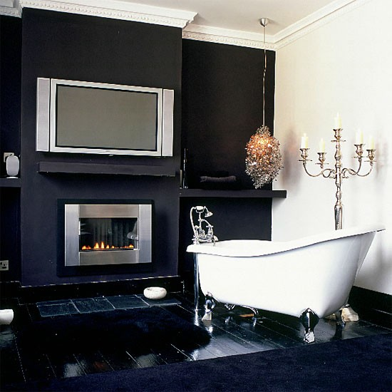 Monochrome Bathroom With Flat Screen Tv And Fireplace