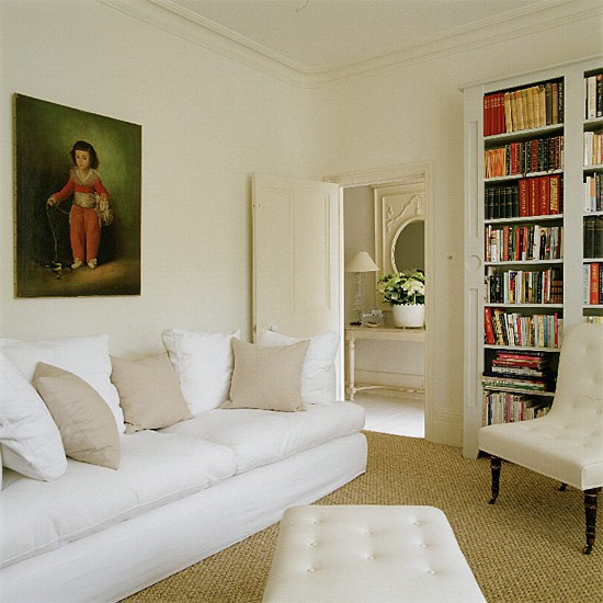 living room with portrait sofa and built in shelves