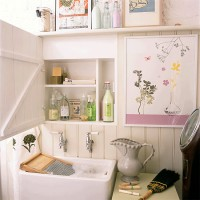 Comact utility room with built-in storage and panelling