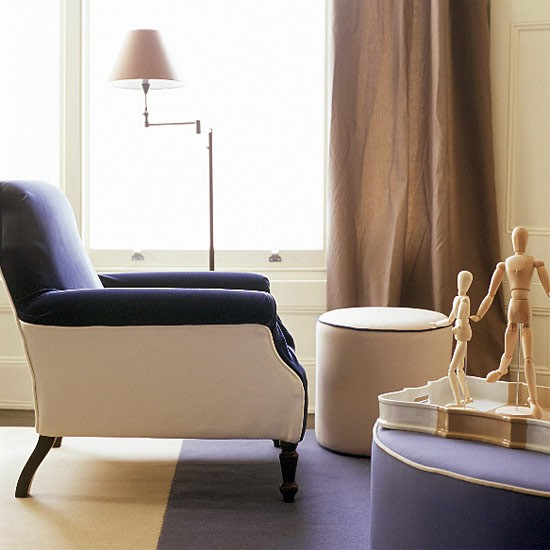 Neutral Room With Blue And White Armchair And Pouffes