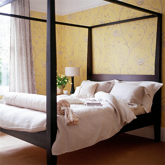 Yellow Room With Patterned Wallpaper And Black Four Poster
