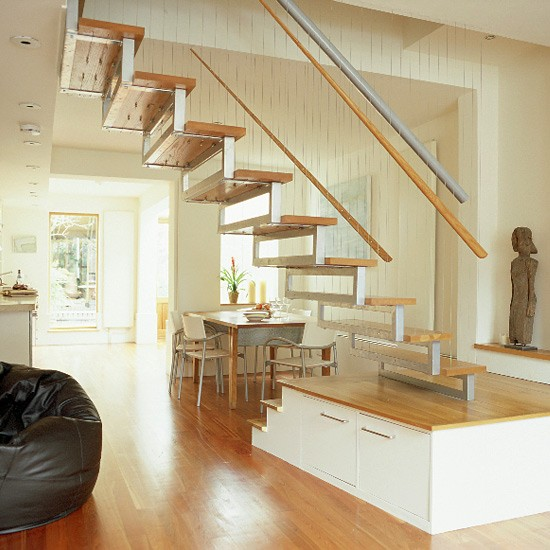 Living Dining Room With Wooden Floor And Bespoke Staircase