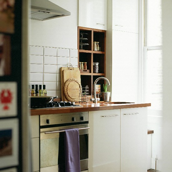 Small Kitchen With White Units And Iroko Worktops