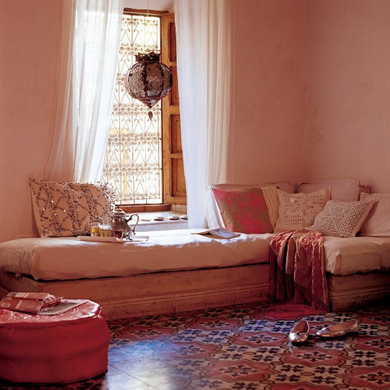 Moroccan inspired room with patterned accessories for Moroccan living room ideas