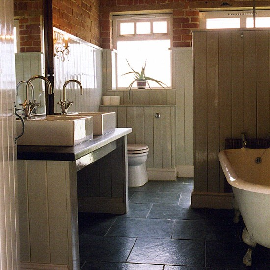 Bathroom with panelling stone floor and modern suite for Bathroom ideas using tongue and groove