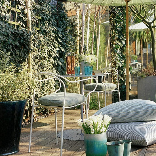 Tranquil and shady garden dining area relaxing garden for Tranquil garden designs