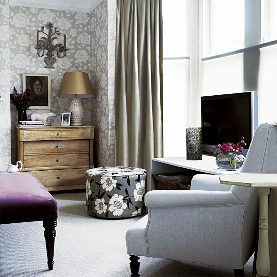 Living room with floral walls footstool chair and tv for Traditional living room ideas uk