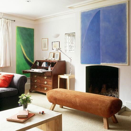 Paintings By Owner Julie Sutcliffe Hang In A Living Room Full Of