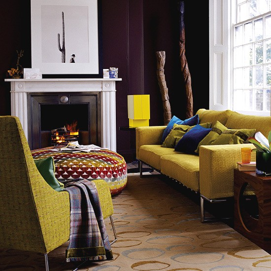Living room with brown walls and bright furniture for Mustard living room ideas