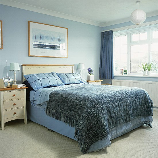 bedroom with blue walls and accessories and white