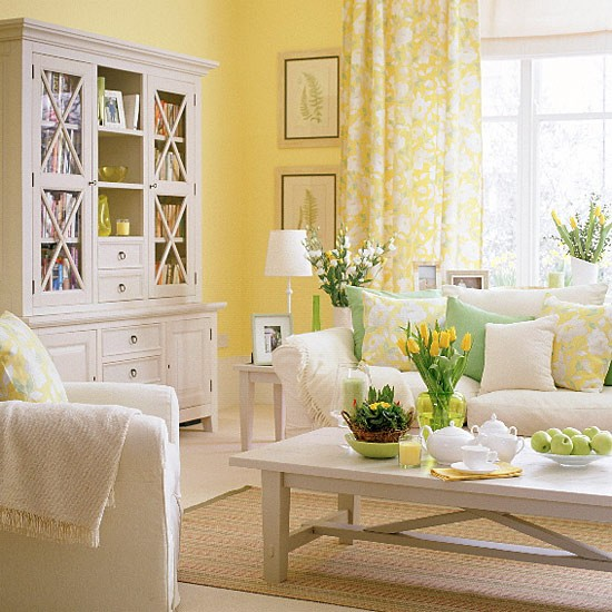 living room with white furniture and green and yellow