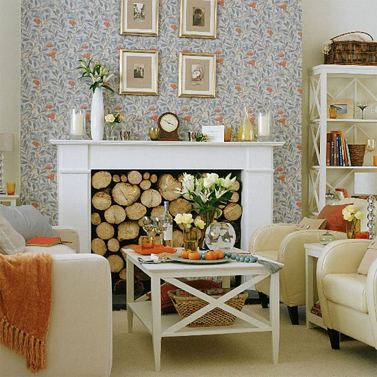 Living room with floral wallpaper cream chairs and coffee for Home decorating company