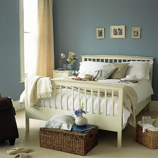 Blue Bedroom With Painted Wooden Bed