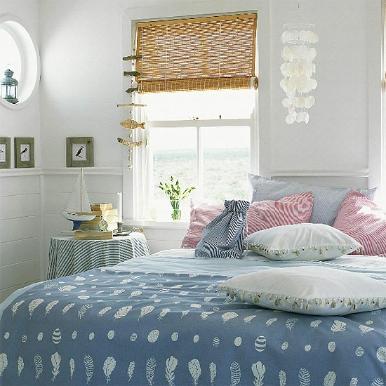 Bedroom With Blue Bedding And Seaside Accessories