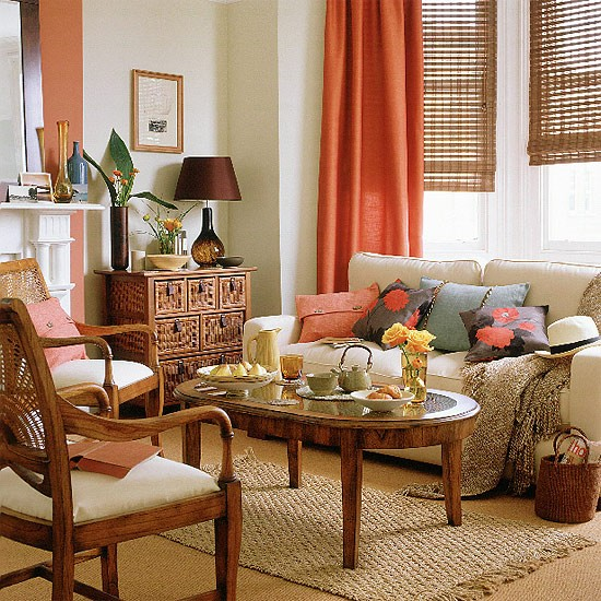 Neutral Living Room With Cream Sofa Wooden Furniture And Orange Curtains