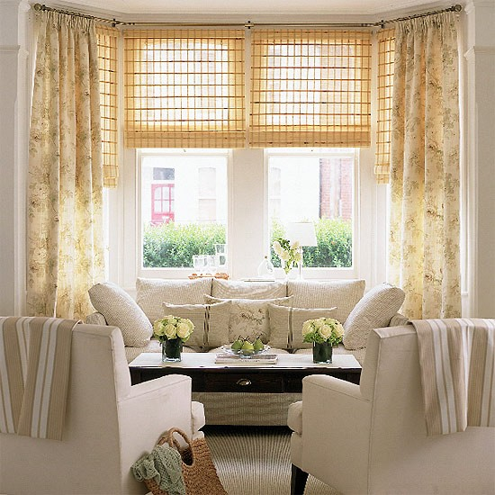 Living room with cream furniture floral curtains and for Living room blinds