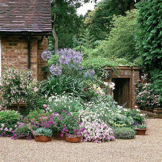 Softening the corner of a house for Country garden designs landscaping