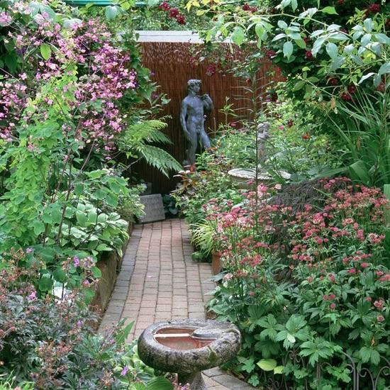 garden with sculpture garden design decorating ideas. Black Bedroom Furniture Sets. Home Design Ideas