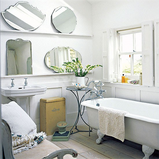 White farmhouse bathroom bathroom vanities housetohome for Modern country bathroom decorating ideas
