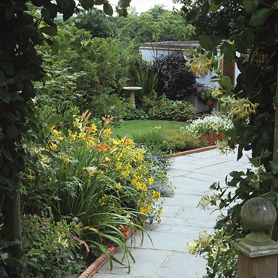 Garden with leafy archway and path | Garden furniture | Image | Housetohome