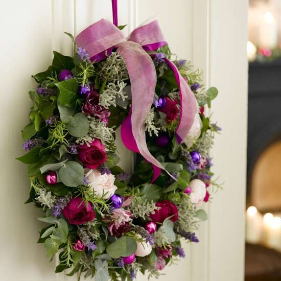 A fragrant Christmas wreath will delight guests before they step through the door