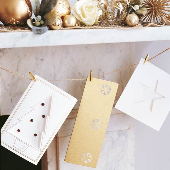 Hang Christmas cards with string to keep surfaces free