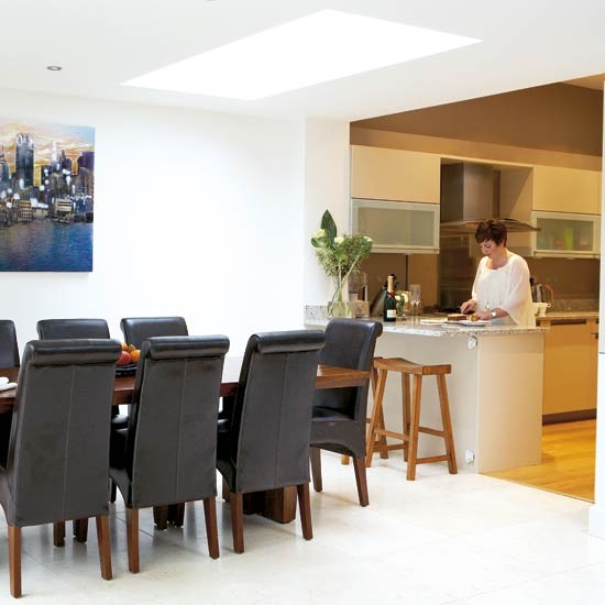 Modern kitchen with open design and dining table Contemporary open plan kitchen