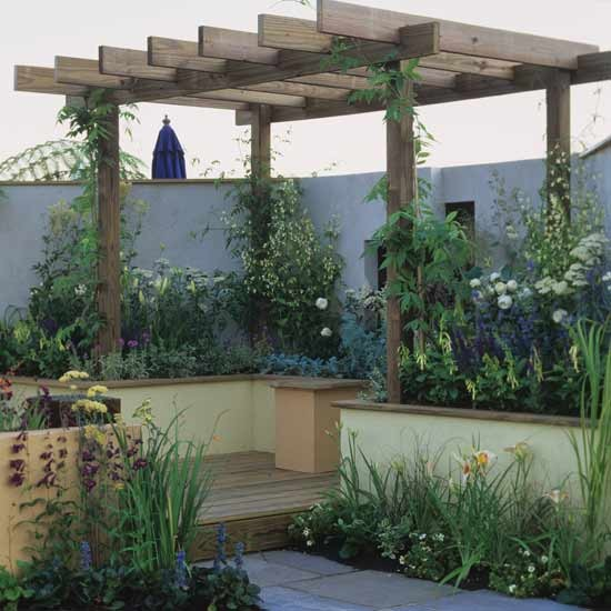 Small garden with wooden pergola garden design for Garden decking ideas uk