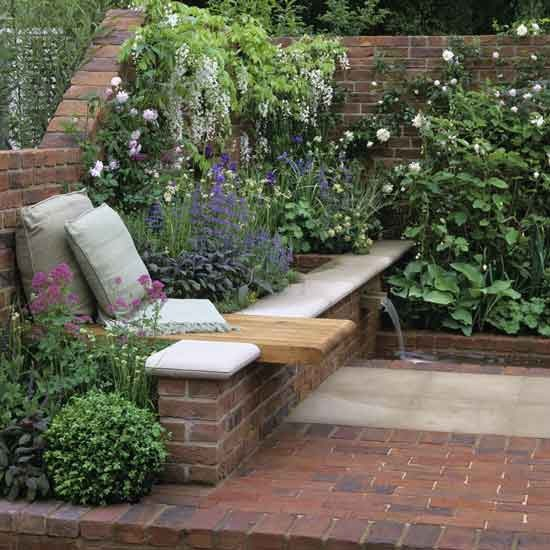 Corner floral garden area garden design decorating for Garden ideas for patio areas