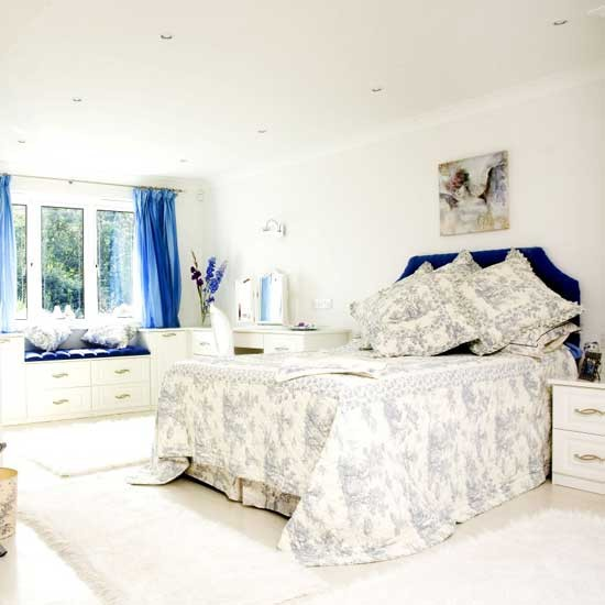 White guest bedroom with blue accents Bedroom furniture