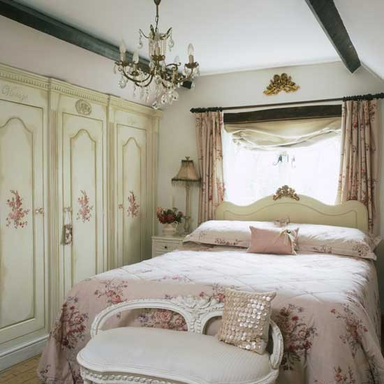 Floral Designs And Antique Furniture Transform This Bedroom Into A