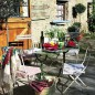 Rustic metal table and chairs on French-style terrace
