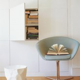 Go for the minimalist look with a bank of handleless cupboards recessed into the wall
