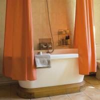 Compact bathroom with freestanding bath