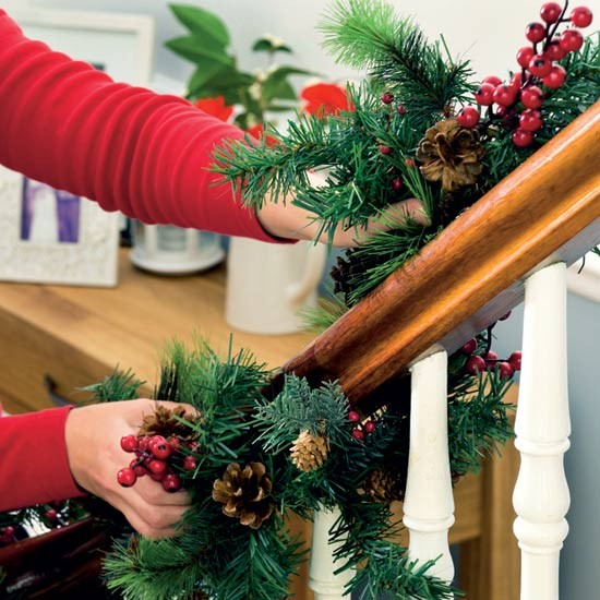 Wind a garland around banisters christmas decorating for How to decorate a banister