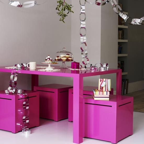 Pink dining table and stools dressed for Christmas  Modern Christmas