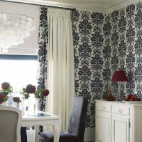 Curtains made in Austen Off White, £15 per m; and Tatton Charcoal, £35 per m; both Laura Ashley