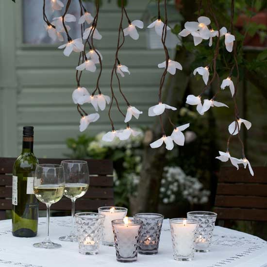 atmospheric lighting create an elegant look for outdoor entertaining