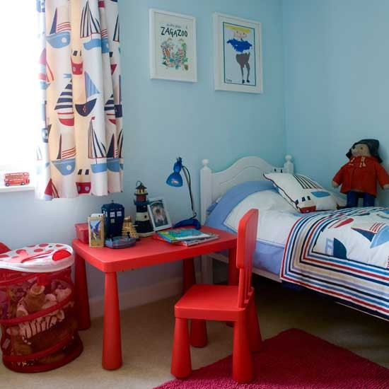 Nautical boys bedroom with bright red desk Boys bedroom